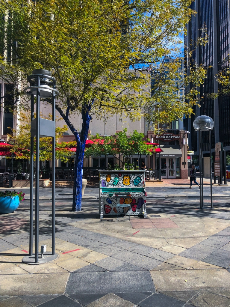 outdoor piano sitting on 16th Street Mall
