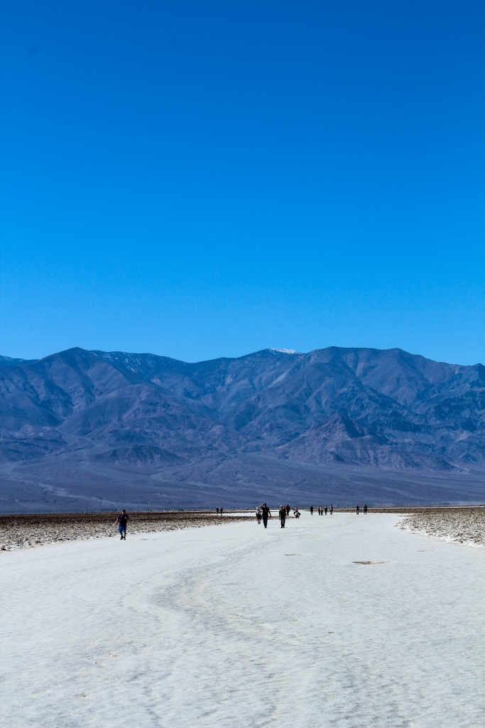 people walking on the salt flats at Badwater Basin